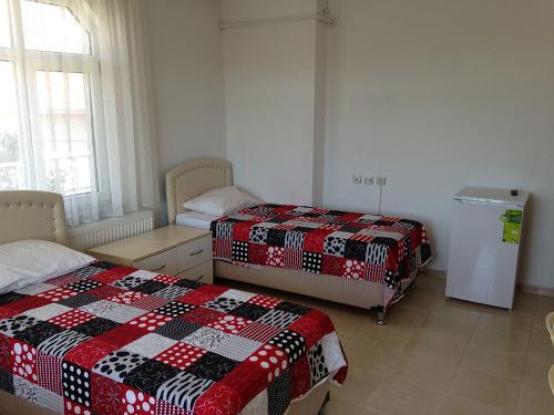 Turuncu Pansiyon Kız Yurdu - 3 kişilik oda